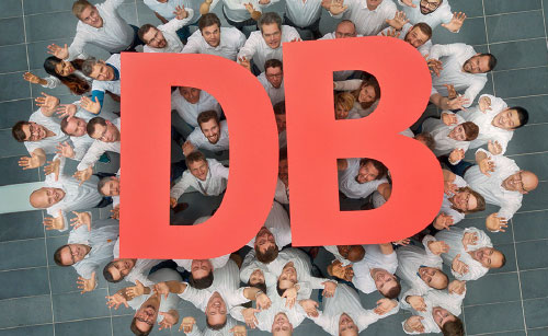 Lot of people holding the DB Logo